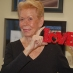 Louise Hay with Love Sign
