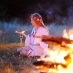 A woman attends a pagan ceremony