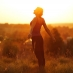 Woman in field at sunrise