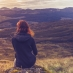 Girl contemplating sunset