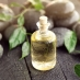 Aromatherapy bottle and tea tree leaves