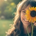 girls smiling with sunflower