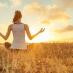 A woman meditating in a field