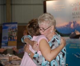 Louise Hay hugging fan
