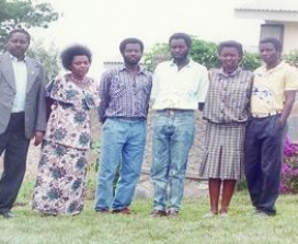 "mmaculée Ilibagiza's family poses in front of their home. All of Immaculée's family but one brother were brutally murdered during the Rwandan Holocaust. ""I have learned that God does not work on a human timetable and that miracles come to us through our prayers, not according to our calendars."" –Immaculée Ilibagiza"