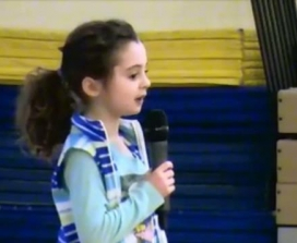 Avery teaches meditation to her school assembly