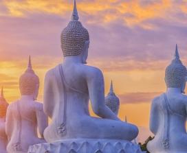 Stone Buddhas at sunset