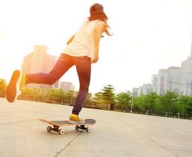 A woman skateboarding through a city