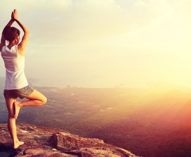 a woman doing yoga on a mountain