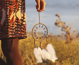A woman carrying a dream-catcher