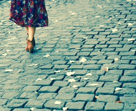young woman in boots cobblestones