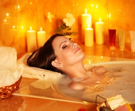 woman in bath with candles