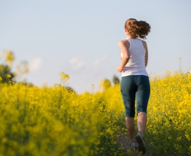 girl running in flower field