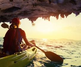 Woman canoeing ocean