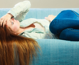 red-haired woman lying on couch