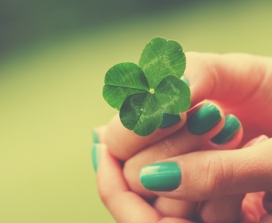 woman holding shamrock green nails