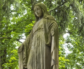 Stone Statue of Virgin Mary In Park Setting