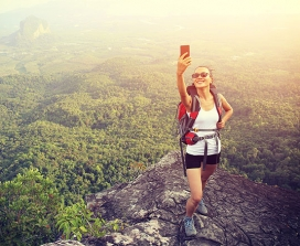 A woman taking a selfie on a mountain