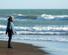 woman on beach in winter