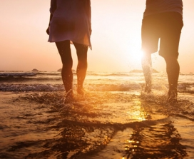 couple on the beach wading