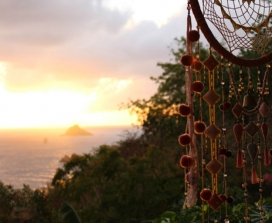 Dream catcher and sunset over ocean