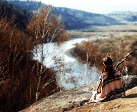 A shaman on a riverbank