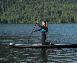 woman paddleboarding on a lake