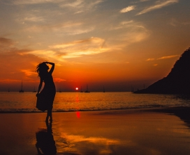 Woman in silhouette on beach