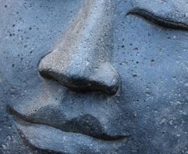 Smiling stone buddha