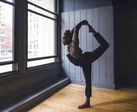 yoga by a city window