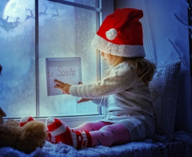 Little girl looking at letter to Santa
