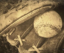 old baseball mitt and glove
