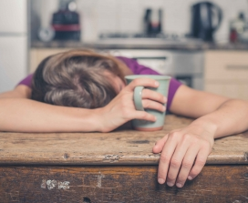 Woman sleeping on kitchen table
