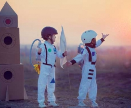 Boys playing at being astronauts