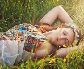 Woman sleeping in a meadow