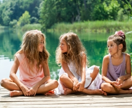 Little girls sitting on a dock