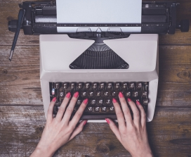 A woman's hands on a typewriter